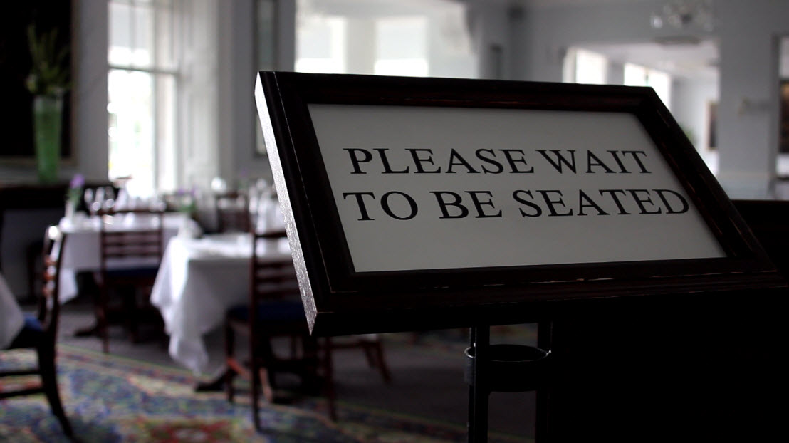 Please-wait-to-be-seated-sign