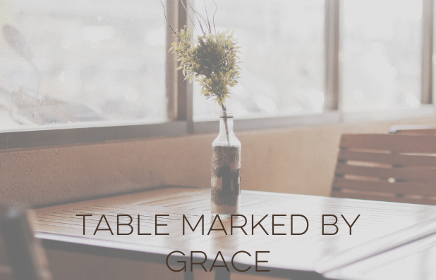 table marked by grace