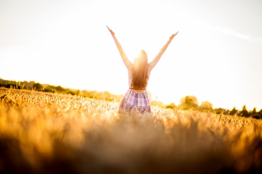 849-woman-raises-her-hands-to-God-in-worship image