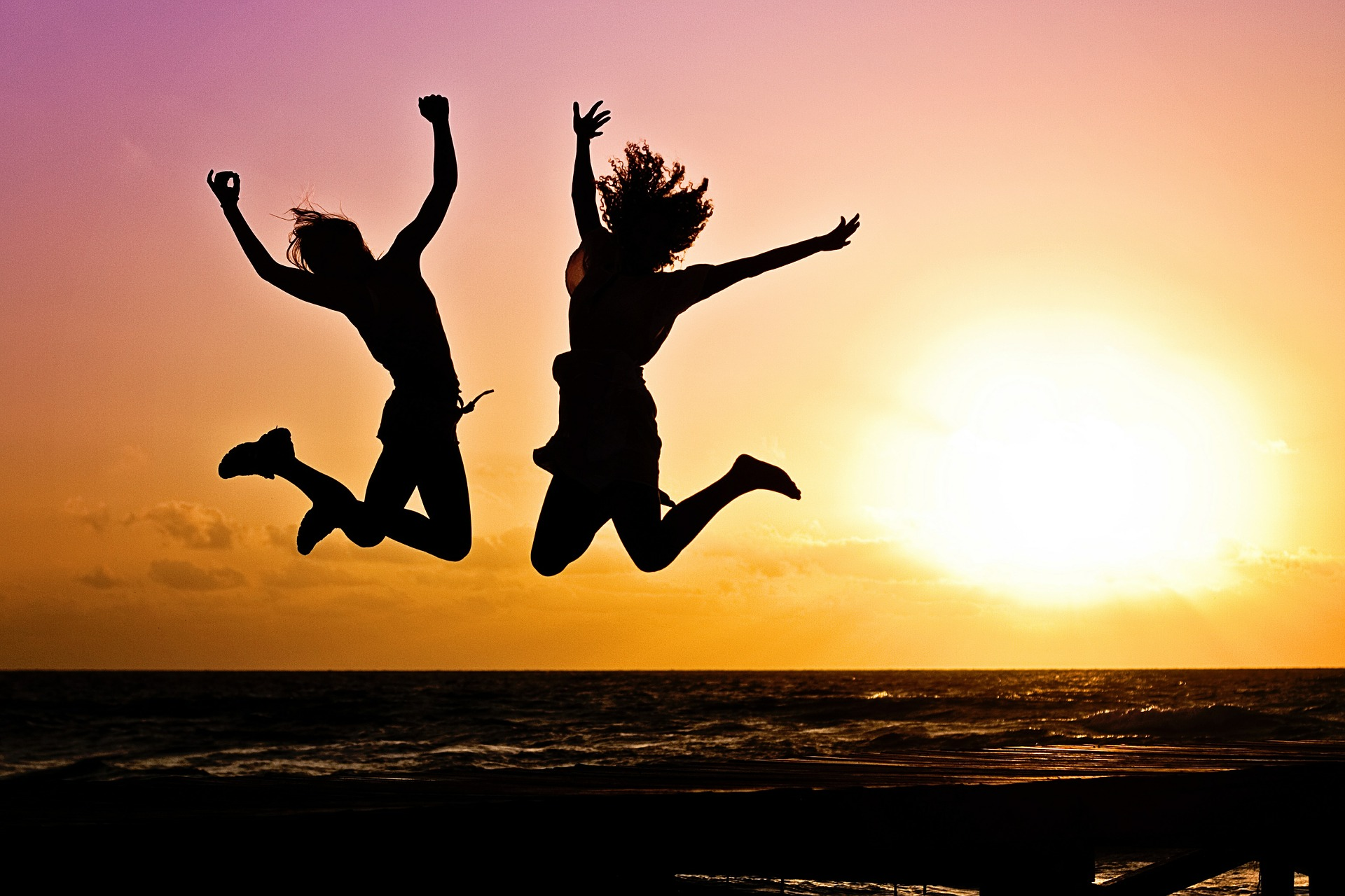 sunset w: youth jumping