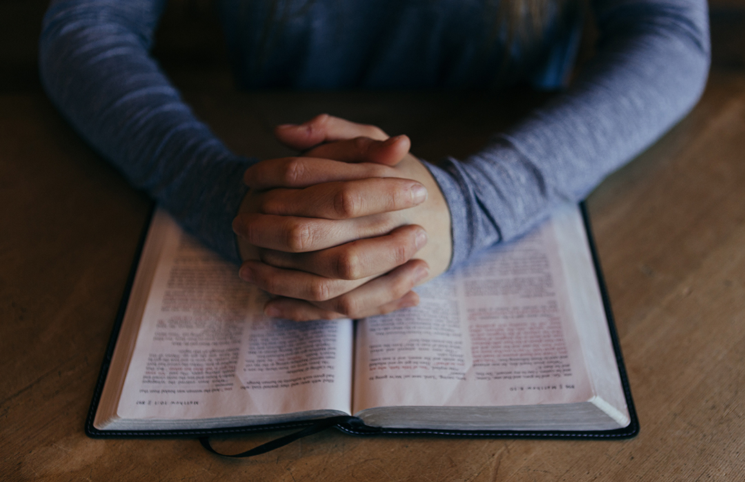 praying-hands-on-bible image