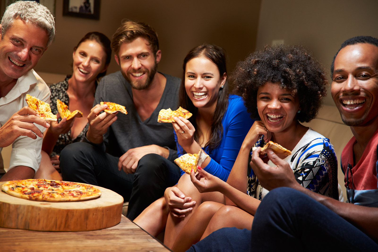 bigstock-Group-of-adult-friends-eating--95387333