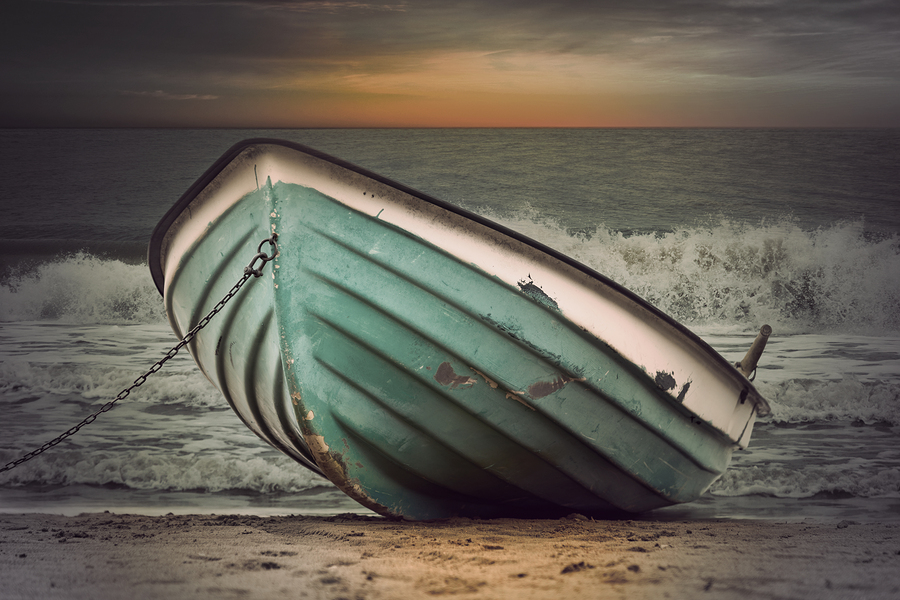 bigstock-Vintage-Boat-In-Stormy-Weather-87716609