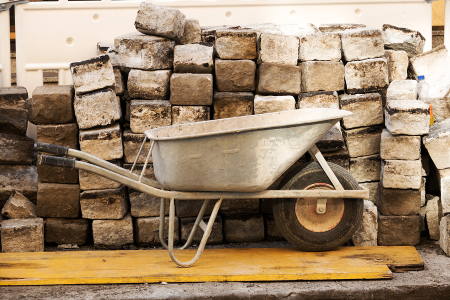 bigstock-wheelbarrow-and-large-stones--79979039