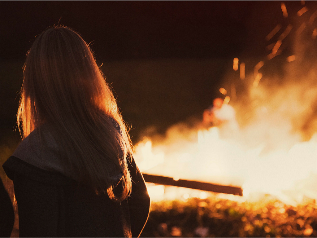 girl looking at fire