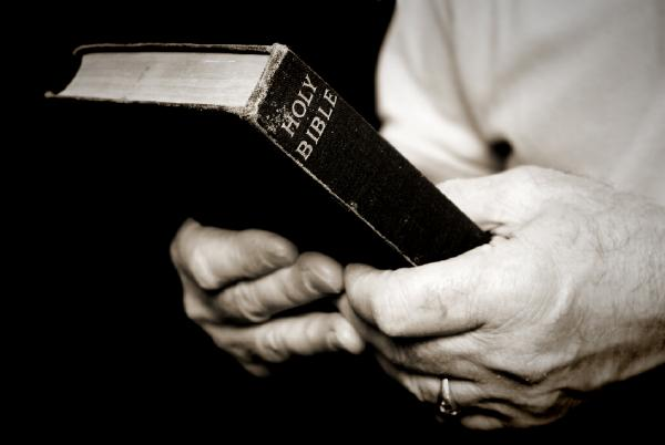 Man_holding_bible-63271