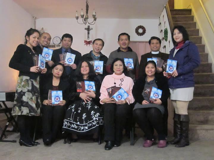 Indonesian Christians holding catechisms
