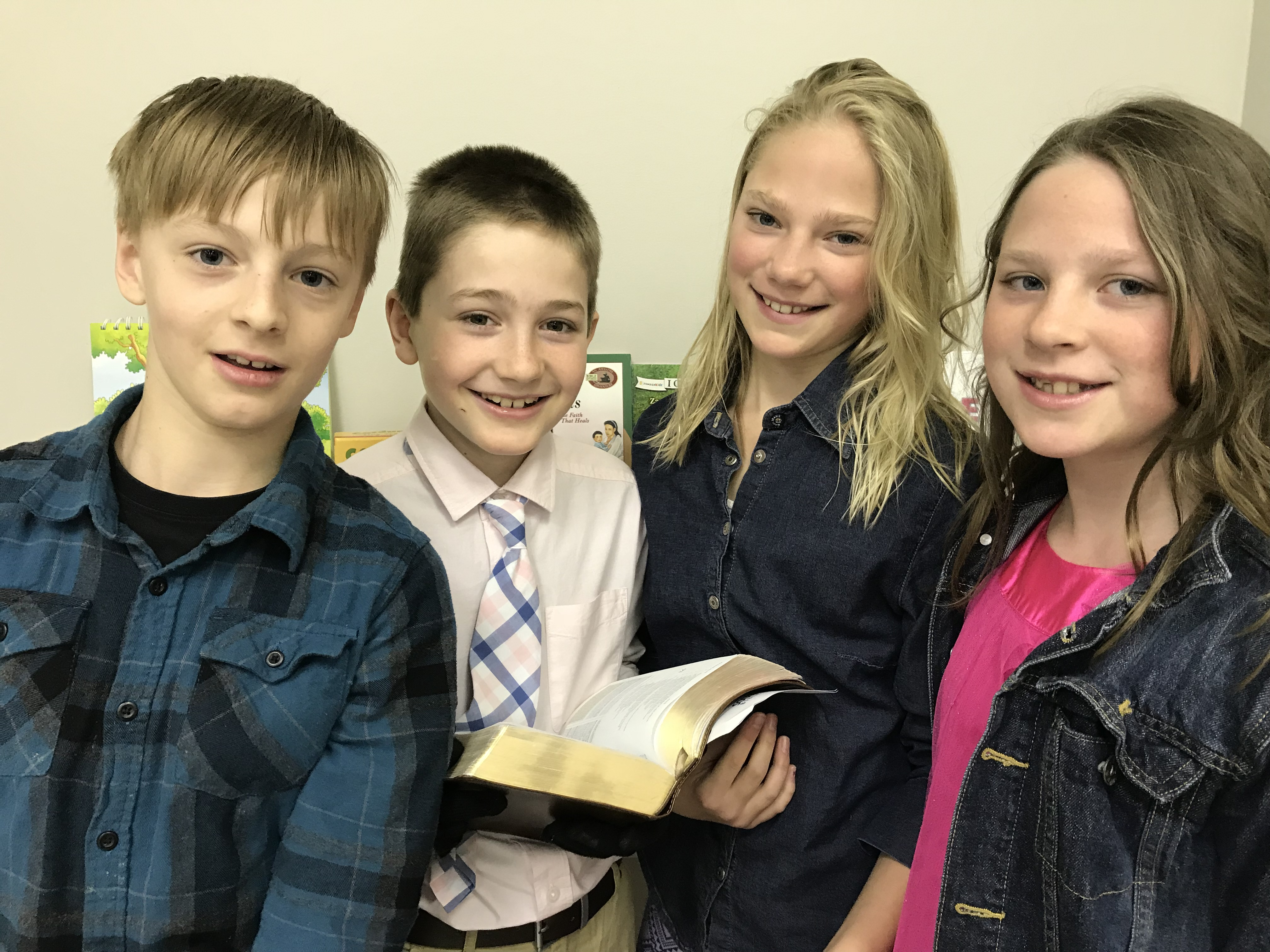 Kids with Bible image