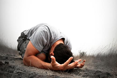 praying_man_in_dirt