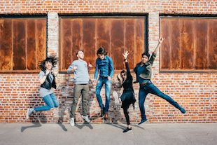graphicstock-group-of-young-beautiful-multiethnic-man-and-woman-friends-having-fun-jumping-outdoor-i image